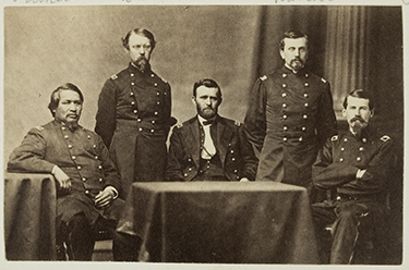 General Ulysses S. Grant and Staff: Ely Samuel Parker (left sitting), Adam Badeau, General Grant (at table), Orville Elias Babcock, Horace Porter. WIKIPEDIA