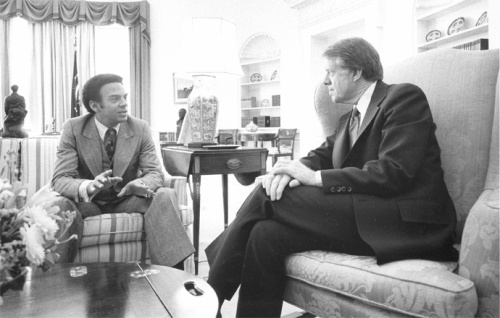 Ambassador to the United Nations Andrew Young meeting with President Jimmy Carter. Young served as ambassador during 1977-1979, but was forced to resign because of an unauthorized meeting with Palestinian diplomats. (Photograph from Still Pictures Unit, National Archives and Records Administration, RG 59-SO, box 39)