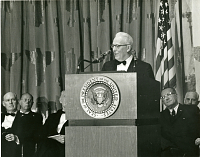 Chief Justice Warren Speaking at the Museum of History and Technology Dedication, by Unknown, January 22, 1964, Smithsonian Archives - History Div, SIA2011-1489 and P-6411-19.