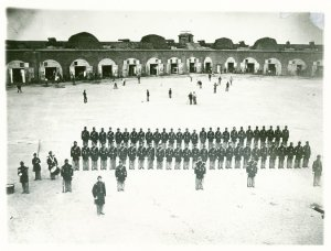 An early version of a baseball game took place in the background as members of the 48th New York State Volunteer Infantry lined up in Fort Pulaski, Ga., in 1862. Credit Western Reserve Historical Society