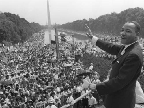 Martin Luther King Jr. waves to supporters on the Mall in Washington, D.C., Aug. 28, 1963. AFP/GETTY IMAGES