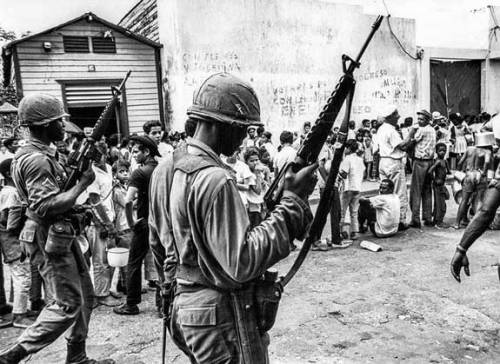 US troops patrol the streets near a food line in Santo Domingo on 5 May 1965 during the Dominican Crisis.